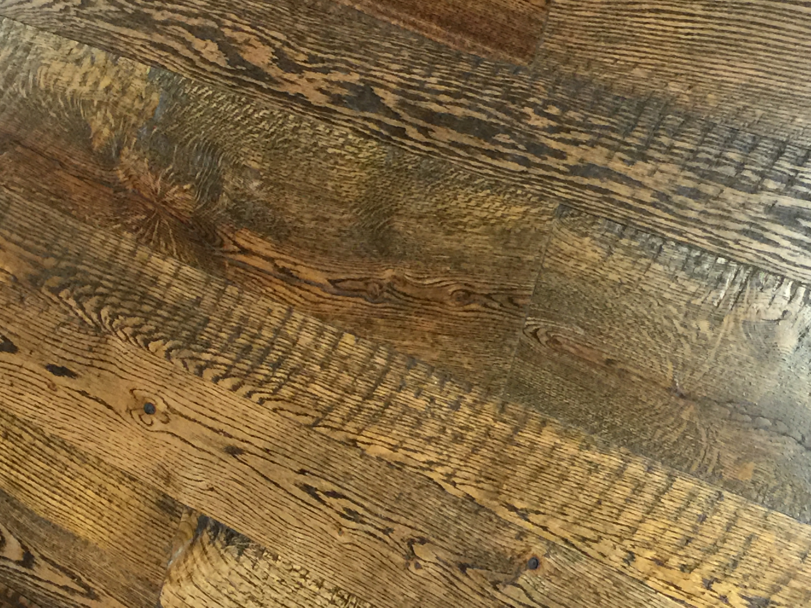 An Example of Classic Plank Red Oak Flooring - Saw Kerf Texture finished with one of Bingham's Custom Stain Mix and Tung Oil Finish