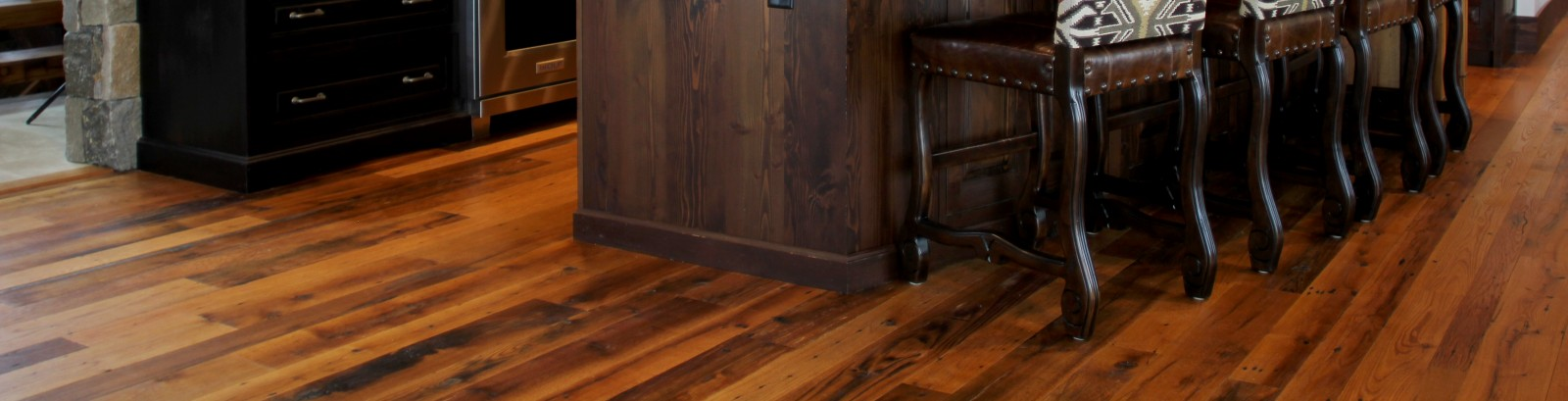 Reclaimed mixed oak flooring with a smooth finish but a beautifully rich character including knots, nail holes and some surface checks