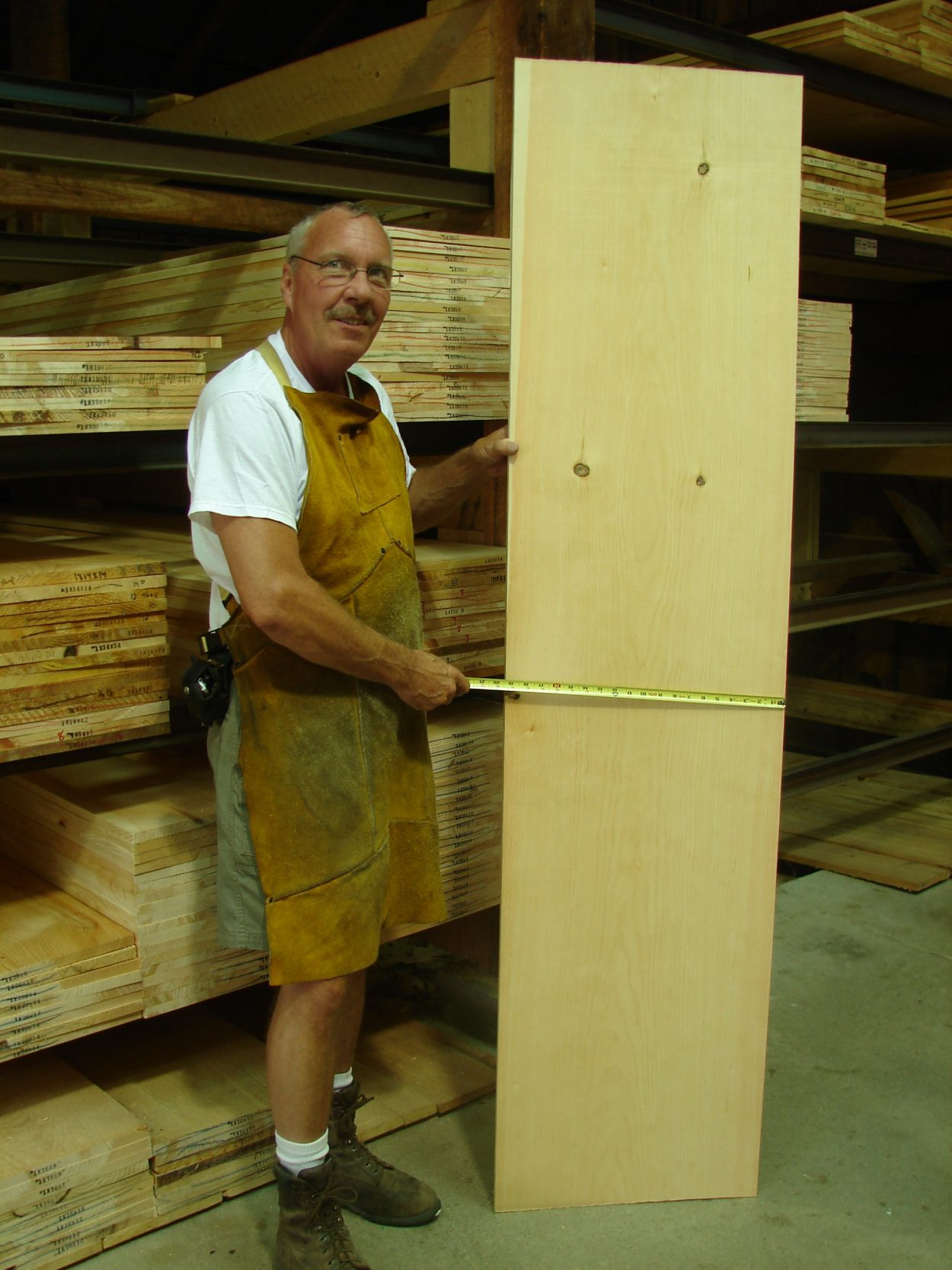 Our Expert Pine Graders Showing off an exceptionally Wide Pine Board